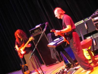 Julie Slick and Adrian Belew onstage at the Rock and Roll Hall of Fame in Cleveland, Ohio, Feb 2007. Photo courtesy Robin Slick