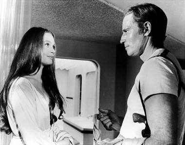 Leigh Taylor-Young and Charlton Heston in Soylent Green (1973).
