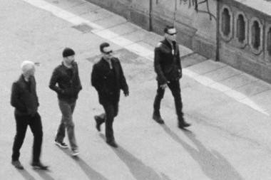 U2 band members walking black and white photo movies and TV