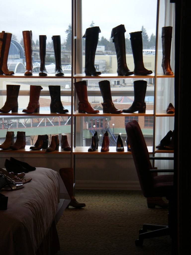 Boots in a window at Western Canadian Shoe Association's Footwear Buying Market.