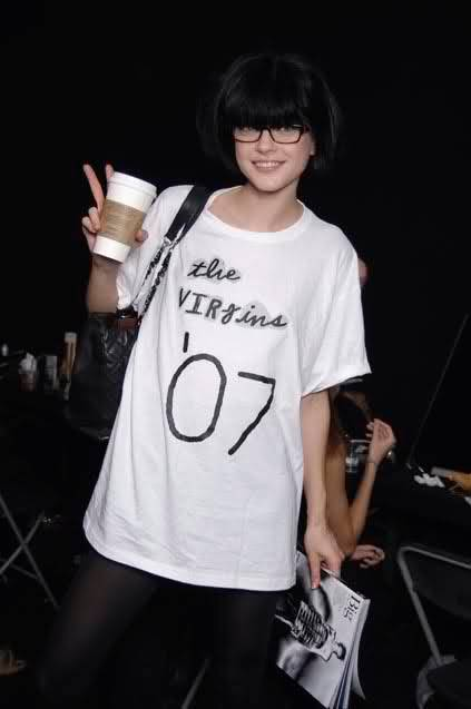 Model Jessica Stam wearing a Virgins T-shirt.
