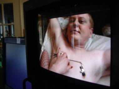 Dave Foley with nipple clamps in Coopers' Camera.