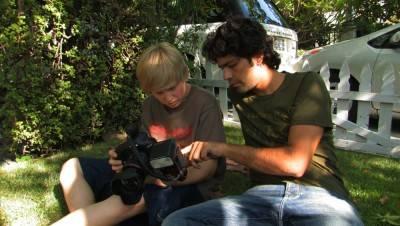 Adrian Grenier and Austin Visschedyk in Teenage Paparazzo.