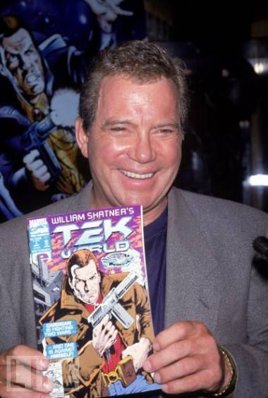 William Shatner with a copy of a Tek comic book.