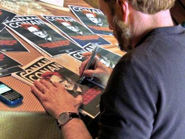 Conan O'Brien signs documentary posters