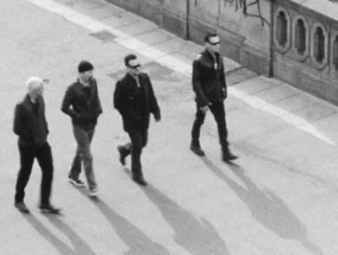 U2 band members walking black and white photo