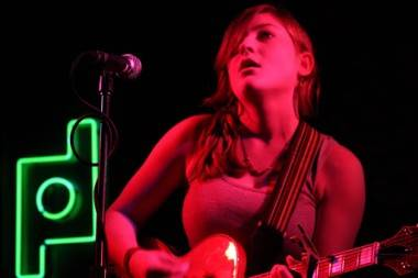 Lauren O'Connell playing guitar